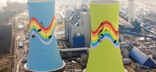 "For the design of the cooling towers, the client PGE chose an artistic concept from among competing ideas submitted by local schools, with rainbow and sun motifs and musical notes from the Polish folk song ""Little Caroline has gone to Gogolina""."