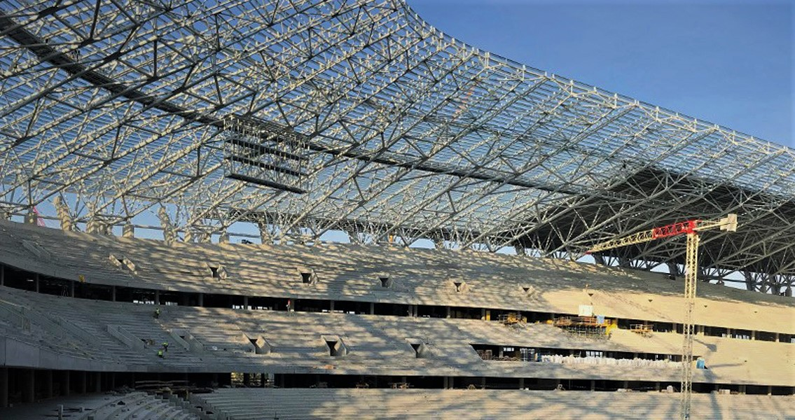 View inside the New Ferenc Puskás Arena in Budapest. There, 15,000 m² of grandstand flooring was coated with MC-Floor TopSpeed flex, the flexible roller coating with crack-bridging properties.