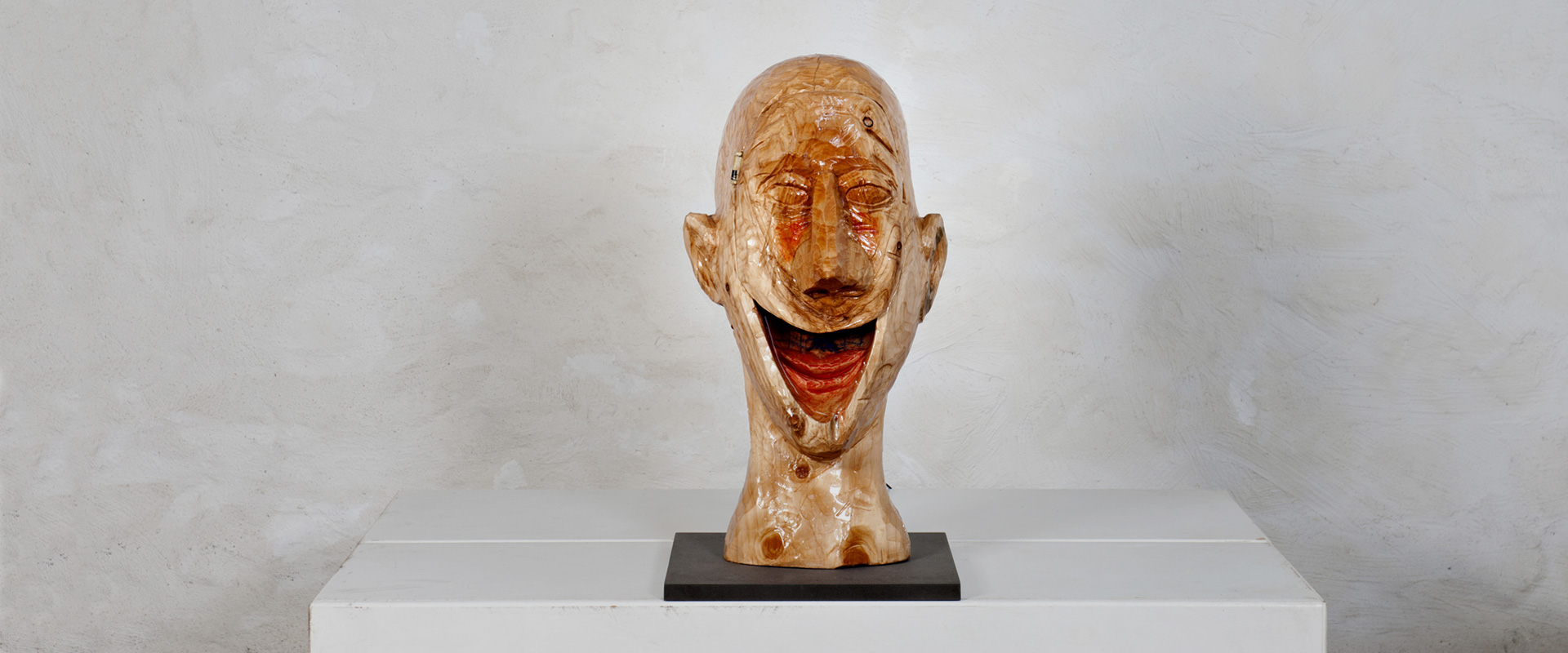 Artist Brele Scholz remoulds wooden European Heads with cast resin